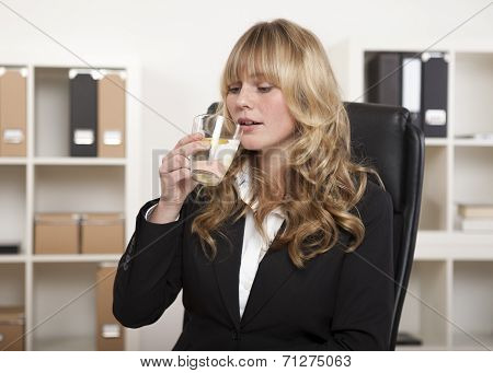 Young Office Worker Enjoying A Glass Of Water