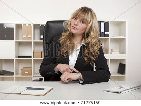 Manageress Pointing To Her Watch