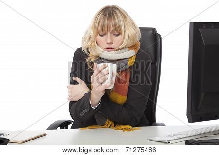Cold Businesswoman Drinking A Mug Of Hot Coffee
