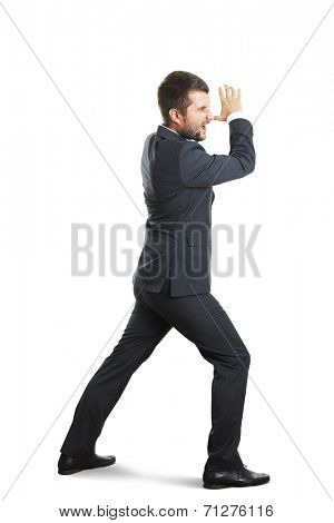 screaming businessman striding over white background