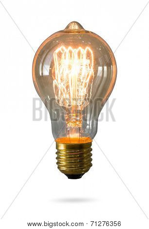Glowing yellow light bulb isolated on white background