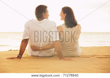 Mature Retired Couple Enjoying Sunset on Beach Vacation