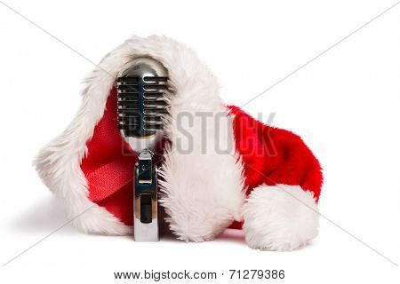 Vintage mic with santa hat on white background