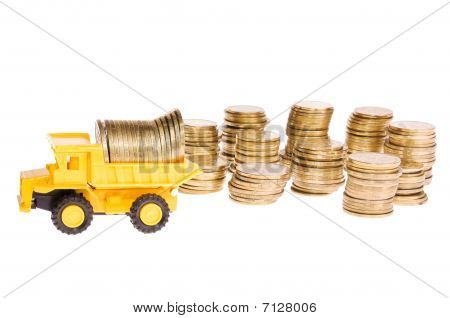 Construction machinery over a lot of golden coins