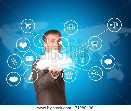 Business man hold cloud with computer icons in hand