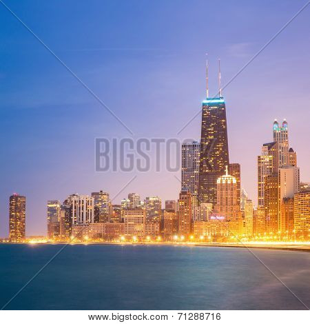 Panorama shot of Chicago downtown and Lake Michigan at dusk.