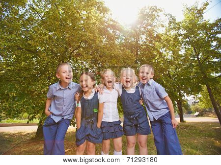 Group of ecstatic friends looking at camera in park