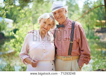 Happy seniors in smart casual enjoying summer rest