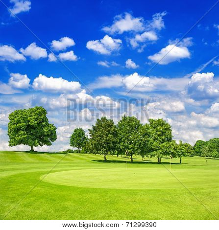 Green Golf Course And Blue Cloudy Sky