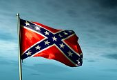 image of confederate flag  - Confederate flag waving in the dark evening - JPG