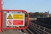 foto of no entry  - electric shock hazard no entry or trespassing sign near rail or train station - JPG