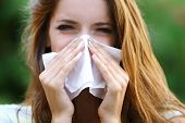pic of allergy  - Young girl with allergy outdoors - JPG