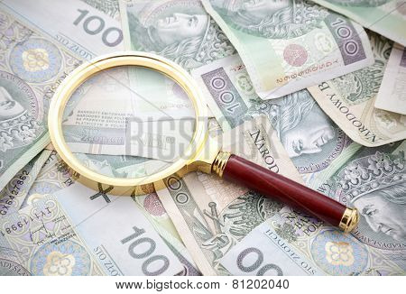 Polish money with golden magnifying glass