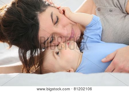 Portrait of mother cuddling baby boy