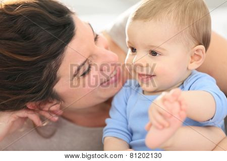 Portrait of happy mother with baby boy