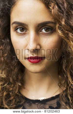 Attractive woman looking into camera