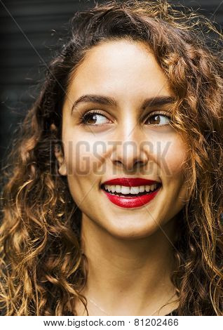 Attractive woman smiles while looking away
