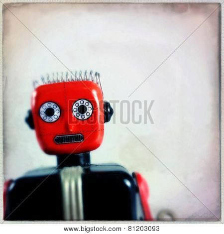 Instagram filtered image of a vintage toy robot