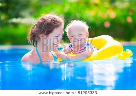 Mother And Baby In Swiming Pool