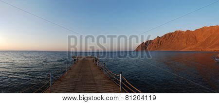 Jetty With Mountain Panorama
