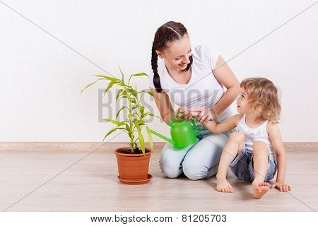 Family Looking After The Plant.