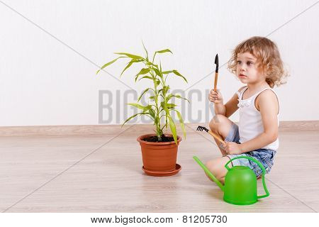 Child Looking After The Plant.