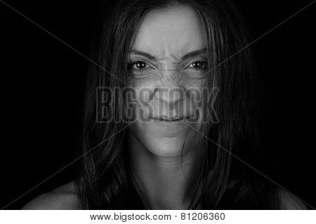 Women Wrinkles Her Nose