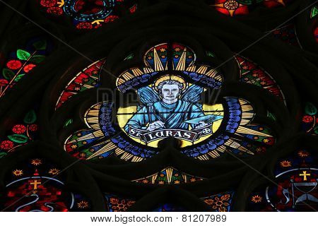 VIENNA, AUSTRIA - OCTOBER 10: Saint Luke the Evangelist, Stained glass in Votiv Kirche (The Votive Church). It is a neo-Gothic church in Vienna, Austria on October 10, 2014