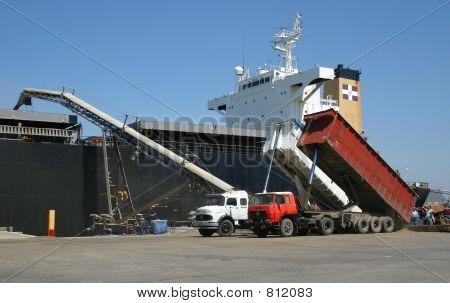Loading grains into a vessel