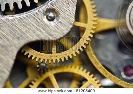 Background With Golden Metal Cogwheels Inside Clockwork. Macro.