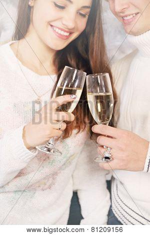 Holding Champagne Glasses