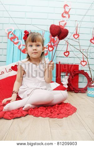 Girl Holding Two Hearts