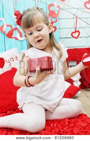 Girl Opens A Gift