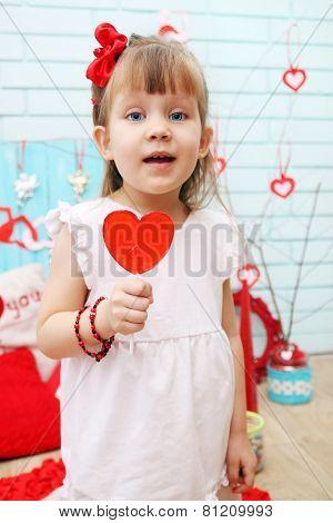 Holding A Lollipop