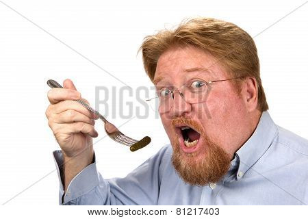Man Eating Pickle On Fork