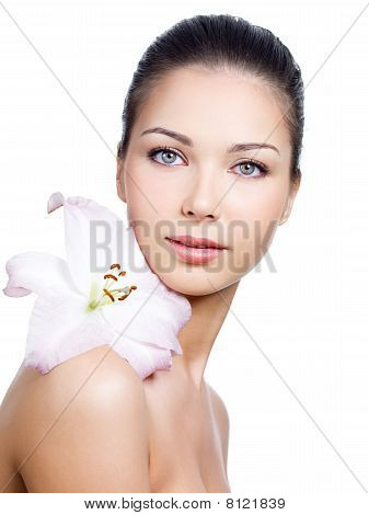 Portrait Of Face Of Woman With Clean Skin And Flower
