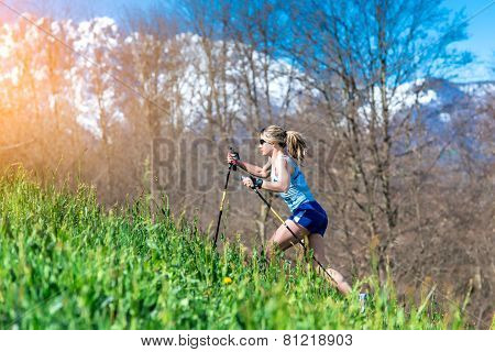 Girl Runs With Sticks In The Mountains