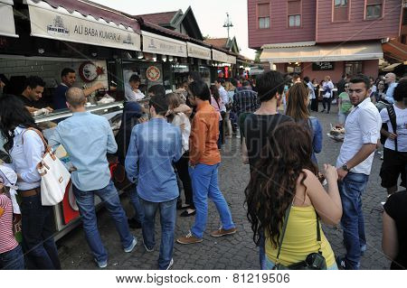 Tourists are buying fast food in Besiktas district near Besiktas ferry station, Istanbul