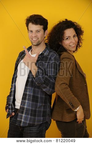 portrait of an happy couple on yellow background