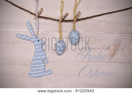 Blue Easter Bunny And Easter Eggs Hanging On Line With German Happy Easter
