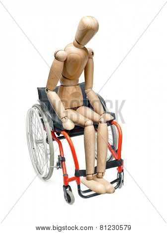 Wooden dummy sitting on wheelchair on white background