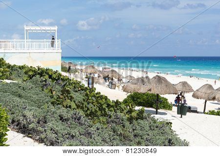 CANCUN - JANUARY 22: Tourists enjoy the sunny weather and relaxing on the Playa Delfines on 22 January 2015 in Cancun, Mexico. This is one of the best beaches in the Mexico.