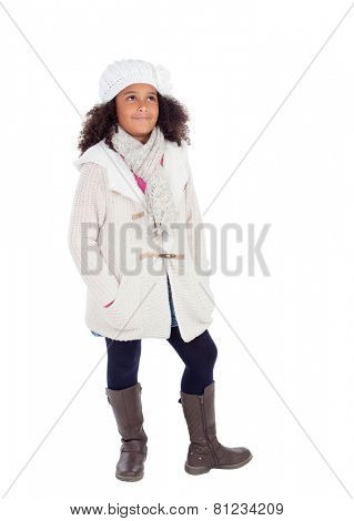 Pretty african girl looking up with winter clothes isolated on a white background