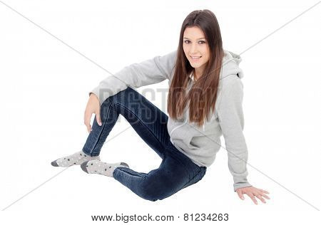 Happy girl with grey sweatshirt isolated on a white background