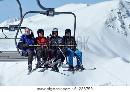 Skiers Going Up With A Ski Lift In A Ski Resort