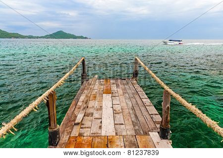 Old Wooden Pier Over The Sea Shore