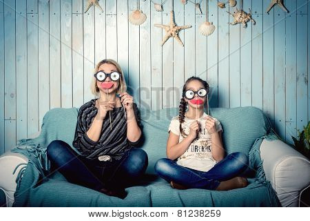 Mom and daughter with false mustaches