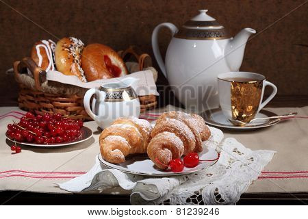 Rolls And Cakes, Tea With Sugar And A Red Currant