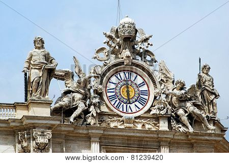 Sculptures And Clock On The Facade Of Vatican City Works