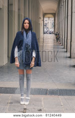 Intentionally Out Of Focus Shot Of A Beautiful Girl Posing In The City Streets